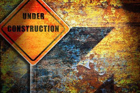 Roadsign under construction rusty wall.