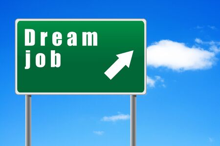 Roadsign dream job on a sky background. Stock Photo