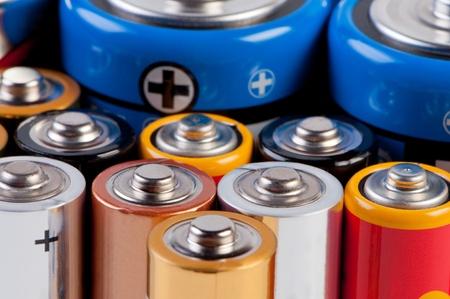Miscellaneous accumulators and batteries close up.