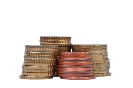 Stacks of coins isolated on white background without shadow. Theme of money and finance. photo