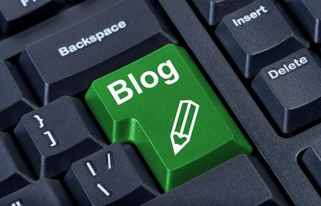 Computer green button blog with pencil, internet concept. photo