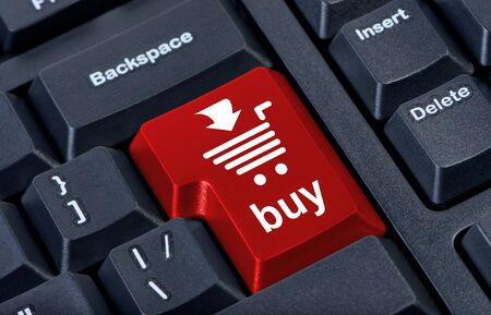 Computer red button buy with cart, internet trade concept. Stock Photo - 10002130