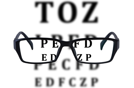 opthalmology: Eye glasses isolated with eye chart background.