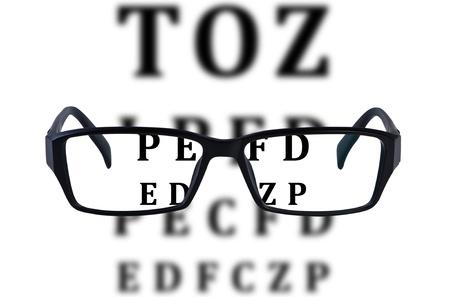 vision test: Lentes aisladas con el fondo de la carta de ojo. Foto de archivo