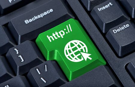 Green button with icon globe, internet concept. photo
