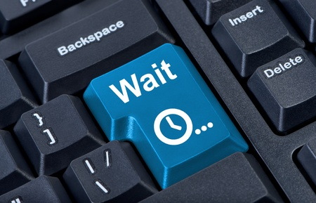 Button wait computer keyboard with clock icon.