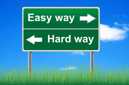easy: Easy way, hard way. Concept road sign on sky background. Stock Photo