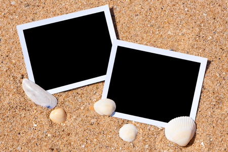 Sea shells with photos on sand background. Traveling to the sea concept.