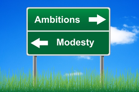 Ambitions modesty signpost on sky background, grass underneath.