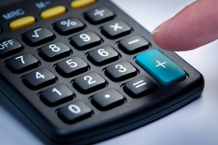 Calculator with finger closeup. Stock Photo - 10536731