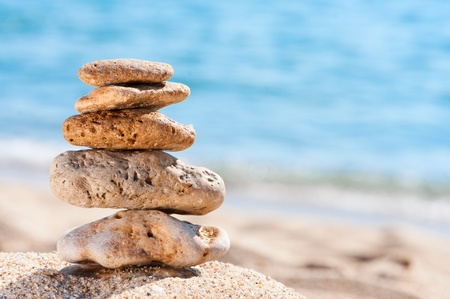 Stones on sand at beach.  Concept for rest, spa, relaxation, resorts.