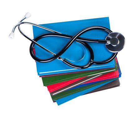 Medical stethoscope on pile books isolated. Stock Photo - 11151310