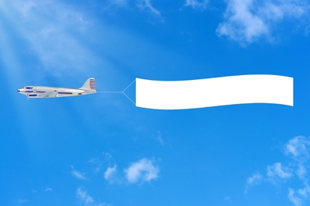 Flying airplane and banner on sky background. Stock Photo