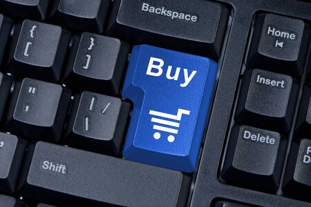 Buy blue button computer keyboard internet concept. photo