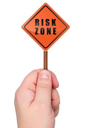 Warning sign risk zone holds in hand. Isolated on white background. Stock Photo - 11536389