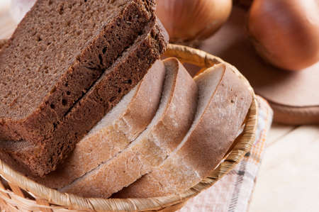 farinaceous: Bread slices in wicker basket, close-up.