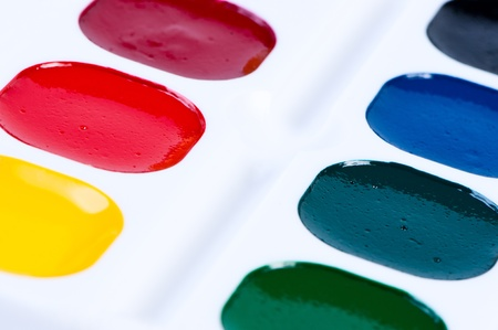 unused: A colourful unused set of watercolour paints in their paintbox such as would be given to a child for school.