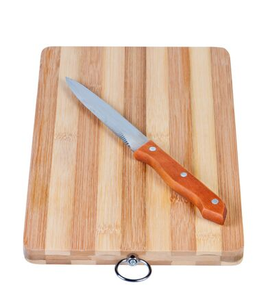 Cutting bamboo board with kitchen knife isolated on white background photo