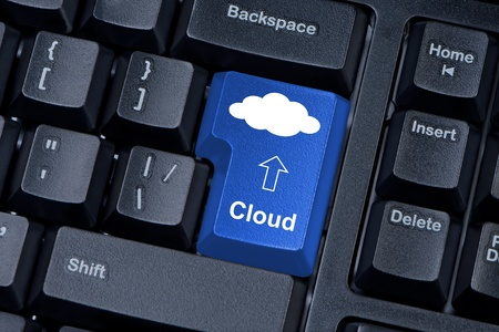 Computer keyboard button blue color with cloud  Concept of computer systems located in the  cloud  photo