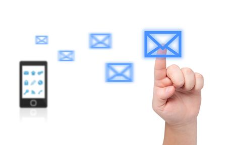 e mail: Finger pressing on envelope  In background is blurry cell phone with flying envelopes  Stock Photo