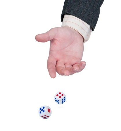 Hand throws dice isolate on white background. Concept of game, luck and success. photo
