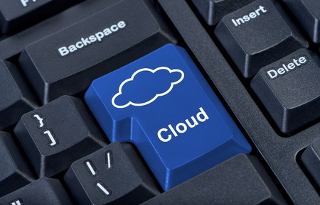 storage device: Symbol of cloud on computer button keypad. Stock Photo