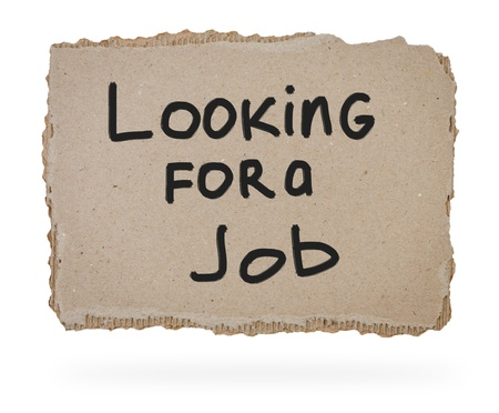 Piece of cardboard with inscription Looking for a Job.