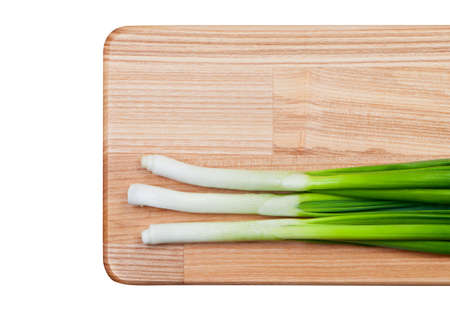Green onions on cutting board top view. photo