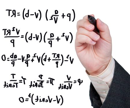 equations: Hand with marker writing formulas and equations.