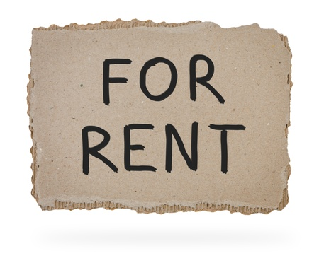 for rent: For rent written in marker on piece of cardboard.