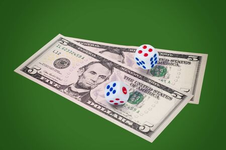 Money with dice on green background. Concept of success and winning. photo