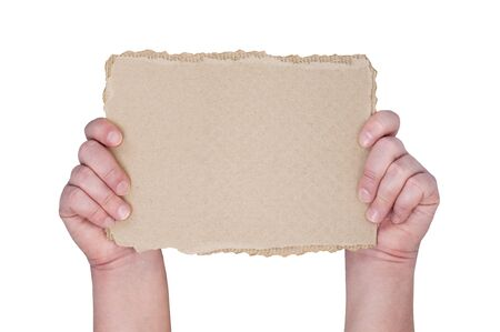 demonstrate: Hands holding scrap of cardboard with space for text.