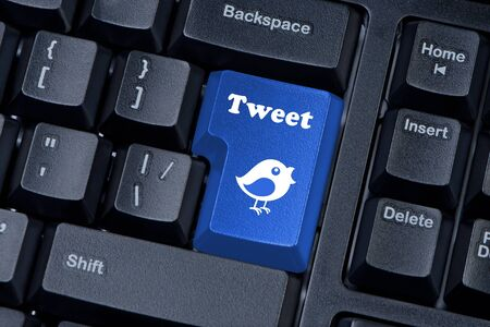 Button keypad with tweet and bird closeup. Stock Photo - 14308289