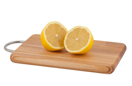 Two halves cut lemon on cutting board isolated on white background. photo
