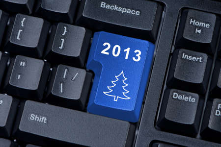 Button computer keyboard with a Christmas tree and figures 2013 photo