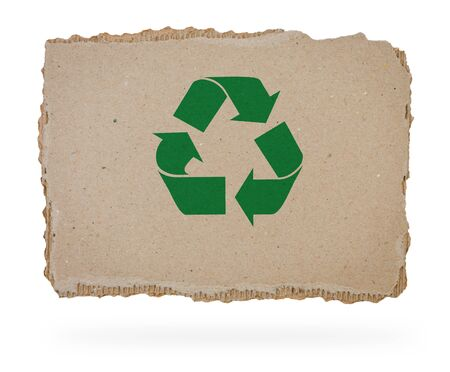goffer: Green resecycle sign on piece of cardboard.