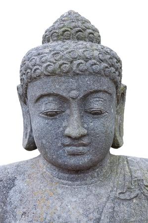 Stone head of Buddha close-up isolated on white background. Standard-Bild