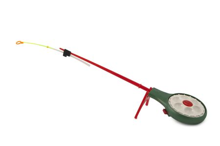 ardour: Winter fishing rod on a stand isolated on white background Stock Photo