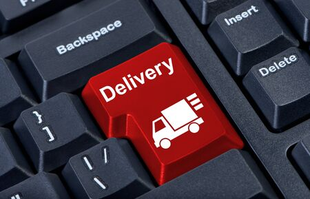 Delivery bright red button computer keyboard with car. Stock Photo