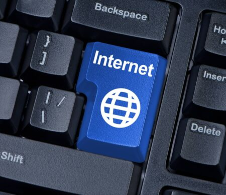 Internet keyboard button with globe. Stock Photo - 17842399