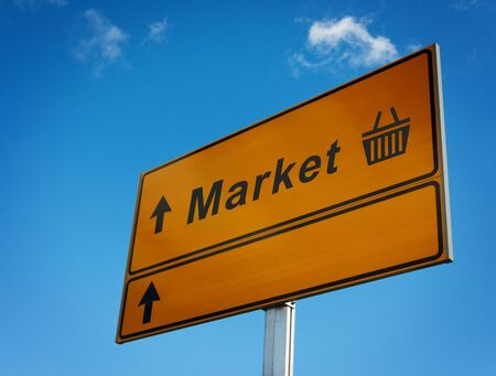 market place: Market road sign with arrows and cart. Bottom place for your text. Stock Photo