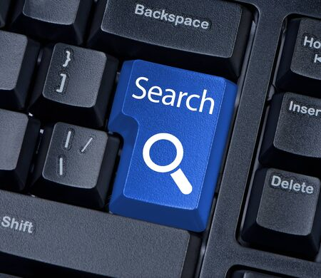 Search button computer keyboard with magnifying glass Internet concept. Stock Photo - 17842400