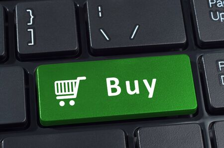 buy button: Buy button computer keyboard with trolley icon. Internet concept of consumerism and e-commerce.