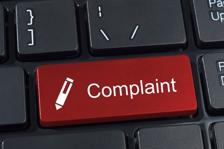 complain: Complaint button keyboard with pen icon internet concept. Stock Photo