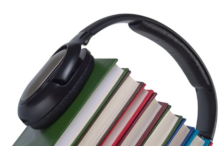 Headphones on books close up isolated white background. Concept e-learning and listening audiobooks. photo