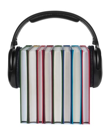Headphones on books isolated white background. Concept of e-learning and listening to audiobooks. photo