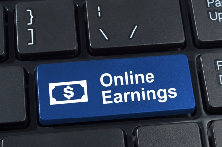 Online earnings computer keyboard button. Concept of earnings money with Internet technology.