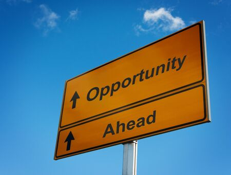 career success: Opportunity ahead road sign Stock Photo
