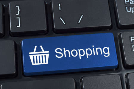 Shopping button keypad with basket icon. Internet concept of consumerism and e-commerce. photo