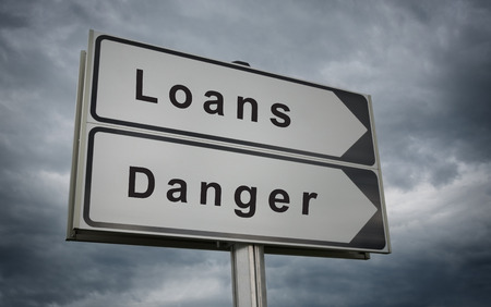 borrower: Loans, Danger road sign. Concept of credit risk. Stock Photo